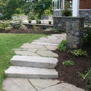A Flagstone Path With Slab Steps Lead To This Backyard Patio. Stone Pillars  Were Built