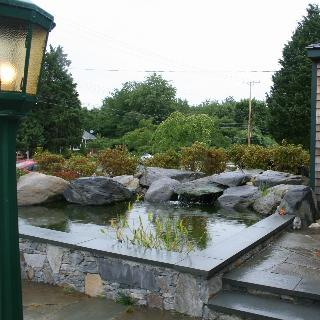 Elegant A Raised Water Feature With Submerged Boulders.